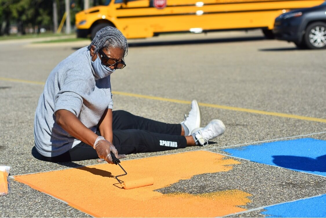 Staff painting parking lot